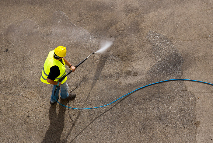 water jetting association worker jetting a concrete surface